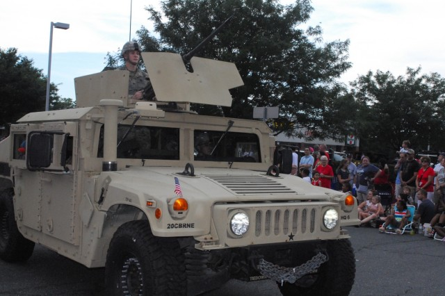 Spc. Albert Vences is the gunner for a Humvee that was part of the 20th CBRNE Command's support to the July 4th parade in Bel Air, Maryland. Spc. Justin LaToree was the driver and the troop commander was Sgt. Maj. David Rio.