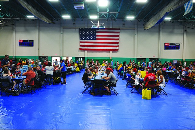 Thousands of Soldiers and their Families sit down to a picnic style meal July 4 at Fort Stewart during the installation's Marne Independence Day Celebration.