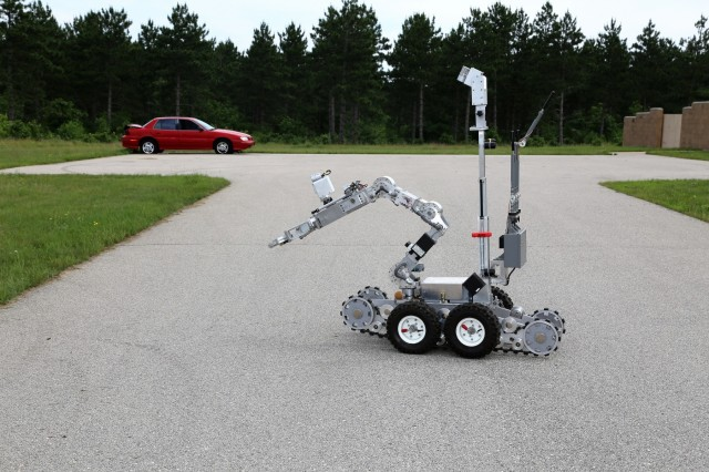 Explosive ordnance disposal personnel operate a remote-controlled robot for a training scenario June 22, 2018, at the Combined Arms Collective Training Facility at Fort McCoy, Wis. The training was part of Exercise Audacious Warrior 2018. Nearly 60 Airmen from 10 states as well as teams of international service members who are part of explosive ordnance disposal teams trained at Fort McCoy for 12 days in late June to early July as part of the exercise. Training also took place at Volk Field, Wis. Throughout the training, the EOD Airmen completed scenarios in convoy operations, populated-area responses for IEDs, and more. (U.S. Army Photo by Scott T. Sturkol, Public Affairs Office, Fort McCoy, Wis.)