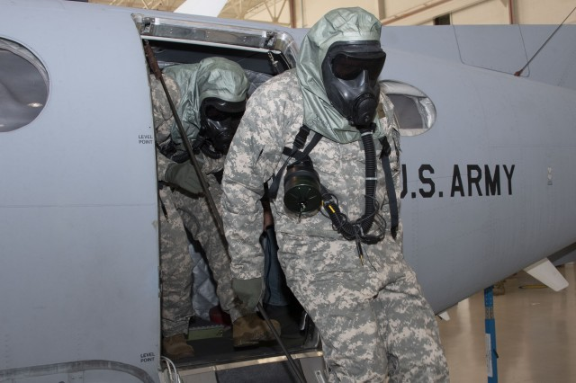 Pilots from the U.S. Army Intelligence and Security Command's 15th Military Intelligence Battalion (Aerial Exploitation) exit an Enhanced Medium Altitude Reconnaissance Surveillance System (EMARSS) aircraft during emergency egress training.
