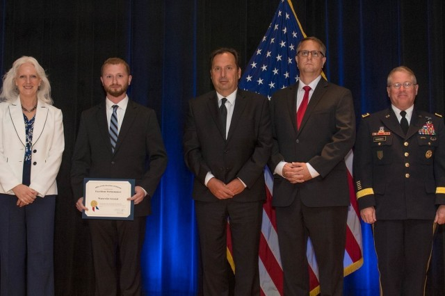 Employees of Watervliet Arsenal accept the Department of Defense Value Engineering Award on behalf of the Apache Production and Fielding Value Engineering Team during a June 28, 2018 awards ceremony at the Pentagon. Presenting the award are Kristen Baldwin, acting deputy assistant secretary of Defense Systems Engineering, and Maj. Gen. Brian Cummings, Program Executive Officer for Ground Combat Systems.  (U.S. Army photo by Zane Ecklund)