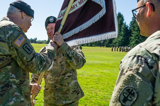 Regional Health Command-Pacific Commanding General Brig. Gen. Dennis LeMaster, left, entrusts the command of Madigan Army Medical Center to Col. Thomas Bundt, center, as outgoing commander Brig. Gen. Michael Place, right, looks on, in a ceremony July 13 at Watkins Field on Joint Base Lewis-McChord, Washington.