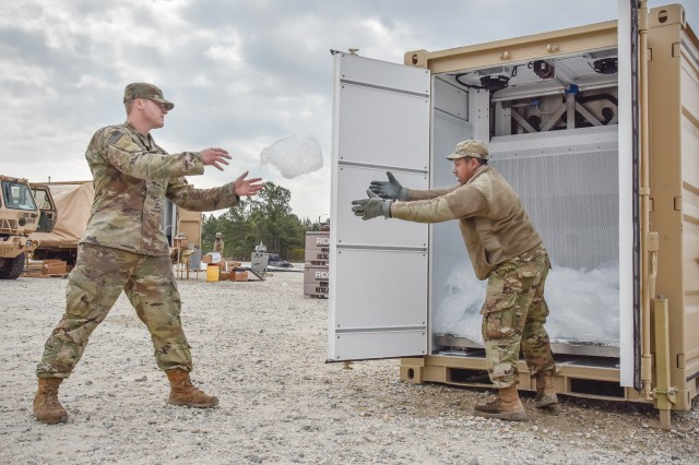 Soldiers from the 3rd Expeditionary Support Command, part of the XVIII Airborne Corps' combat service support element, pass bags of ice from the Containerized Ice Making System, or CIMS, during a training exercise held at Fort Brag in April 2018. The CIMS was developed by the Product Manager -- Force Sustainment Systems, and can successfully generate and bag 3,600 pounds of potable ice per day and keep 1,200 pounds in cold storage for future use.  The CIMS' capacity to produce on-demand ice meets the field feeding, medical, and mortuary affairs needs of Soldiers fighting down range.