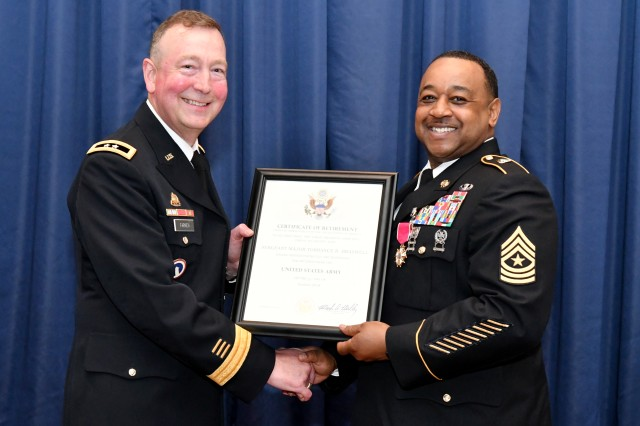 Sgt. Maj. Torrance Braswell, the Military Surface Deployment and Distribution Command's (SDDC) Operations Sergeant Major, is presented with his certificate of retirement by Maj. Gen. Stephen E. Farmen, SDDC commanding general, at Scott Air Force Base, Illinois, July 13.
