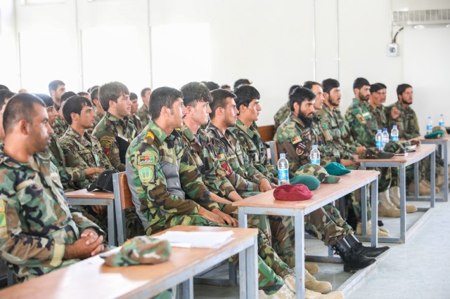 Afghan National Army soldiers from throughout the 205th Corps listen to their senior leaders, July 5, 2018, during the Eagle Strike Company graduation ceremony at Camp Hero, Afghanistan.