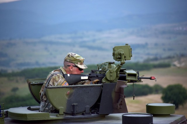 A Soldier assigned to the Ohio National Guard's 838th Military Police Company familiarizes himself with a Serbian military police combat vehicle during the cordon and search portion of Exercise Platinum Wolf 2018, June 13, 2018. Nearly 45 members of the 838th MP Company arrived June 10 in the Republic of Serbia to participate in the exercise. The two-week, multinational peacekeeping exercise brings 10 nations together to enhance military cooperation and interoperability at Serbia's South Base and Borovac Training Area, June 11-22.