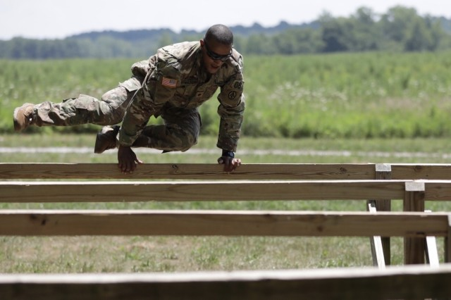 Spc. Jonathan Vazquez hurdles through the confidence course during the AMC Best Warrior Competition. As AMC's Soldier of the year, Vazquez will compete in the Army-level competition in the fall. U.S. Army photo by Sgt. Eben Boothby.