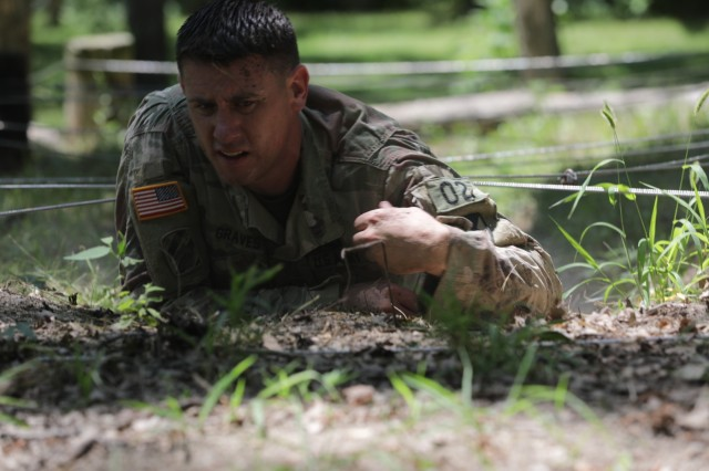 Sgt. 1st Class Joseph Graves crawls through the confidence course during the AMC Best Warrior Competition. As AMC's NCO of the year, Graves will compete in the Army-level competition in the fall. U.S. Army photo by Sgt. Eben Boothby.