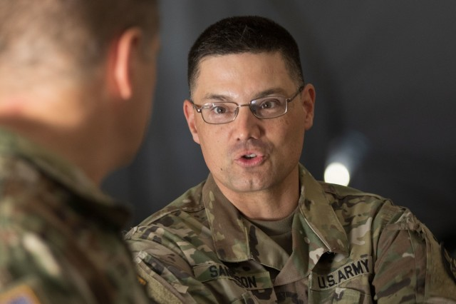 Arizona Army National Guard Col. Christopher S. Sandison, commander of the 198th Regional Support Group, discusses operations with Col. Joseph R. Baldwin, Arizona Army National Guard land component commander, July 9, 2018 at Fort Hunter Liggett, California. Baldwin visited with the 198th Regional Support Group, Headquarters and Headquarters Company which was tasked with facilitating a reception, staging, onward-movement, and integration (RSOI) mission in support of CSTX 91-18-01during their 21-day annual training.