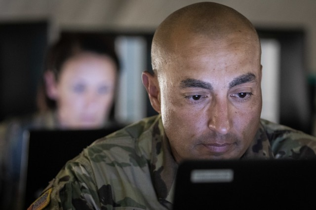 Arizona Army National Guard Sgt. Maj. Edward Jimenez, the operations sergeant major for the 198th Regional Support Group Headquarters and Headquarters Company, works on operating procedures for the tactical operations center July 1, 2018 at Fort Hunter Liggett, California.  The 198th RSG HHC was at Fort Hunter Liggett to participate in Combat Support Training Exercise  (CSTX) 91-18-01, conducted by Army Reserve's 84th Training Command, where their mission was to quickly and efficiently in-process Soldiers and assist units in receiving and staging their equipment to begin CSTX operations.