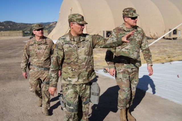 Arizona Army National Guard Col. Christopher S. Sandison, commander of the 198th Regional Support Group, gives Col. Joseph R. Baldwin, Arizona Army National Guard land component commander, a tour of the unit's area of operations during a site visit, July 9, 2018 at Fort Hunter Liggett, California. Baldwin is visiting with the 198th RSG HHC who were at Fort Hunter Liggett to facilitate a reception, staging, onward- movement, and integration (RSOI) mission during a 21-day annual training exercise in support of CSTX 91-18-01, which is a Combat Support Training Exercise conducted by Army Reserve's 84th Training Command.