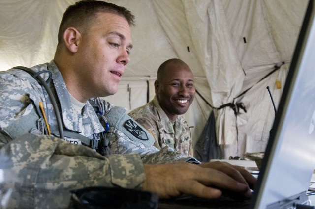 Arizona Army National Guard Sgt.1st Class Darin Hughner and Spc. Kevin R. Mills who are with the 198th Regional Support Group, Headquarters and Headquarters Company, work the front desk at the tactical operations center, June 30, 2018 at Fort Hunter Liggett, California. The 198th RSG HHC was at Fort Hunter Liggett for a 21-day training mission in support of Combat Support Training Exercise (CSTX) 91-18-01.