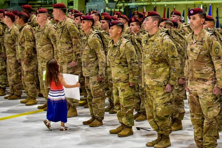 Some Family members couldn't wait to welcome nearly 400 paratroopers from the 4th Infantry Brigade Combat Team (Airborne), 25th Infantry Division, home, June 2, at Joint Base Elmendorf-Richardson's Hangar 1, Alaska, after their return from a nine-month deployment to Afghanistan in support of Operation Freedom's Sentinel.