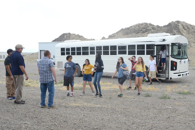 Students arrive at Mustang Village as part of a STEM Outreach program with the University of Utah July 3, 2018. The training facility at Dugway Proving Ground, Utah house various buildings with makeshift laboratories, which provide hands on training in in classroom and field settings for Soldiers and first responders to gain new capabilities in their detection skills for a chemical or biological incident. Photo by Bonnie A. Robinson, Dugway Proving Ground Public Affairs