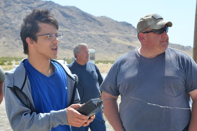 Michael Zahradnik, a high school student, was chosen to detonate a controlled field test at Dugway Proving Ground's large outdoor Tower Grid. The July 3, 2018 test was part of a STEM outreach program sponsored by University of Utah for students interested in pursuing careers in chemistry fields. Photo by Bonnie A. Robinson, Dugway Public Affairs