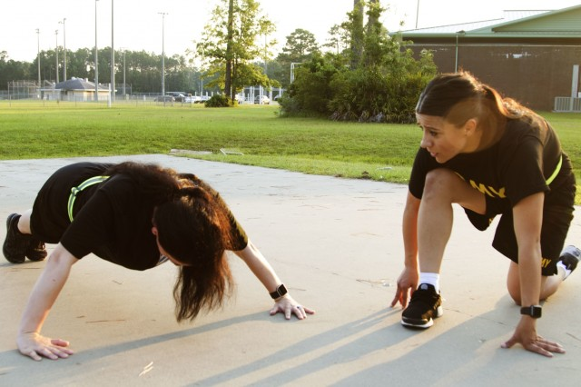Pvt. Crystal Gonzalez and Pfc. Nektaria Seay, financial management technicians assigned to the 24th Financial Management Support Unit, participate in a physical training session at Fort Stewart, Ga., July 13, 2018, as part of a Women's Network Mentorship Network event hosted by the Headquarters and Headquarters Battalion, 3rd Infantry Division Sustainment Brigade. Women from different branches gathered for physical training and a discussion panel to create comradery and discuss what they can accomplish as female service members. (U.S. Army photo by Spc. Derek Greaves, 50th Public Affairs Detachment, 3rd Infantry Division/Released)