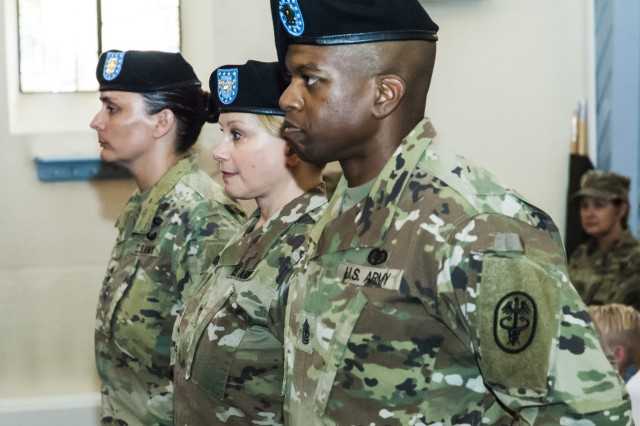 Public Health Command Europe held a Change of Responsibility ceremony Friday, July 13 at the Landstuhl Regional Medical Center Chapel. During the ceremony, Sgt. Maj. Kevin Buie (front) assumed responsibility from Master Sgt. Gina R. Egan (left).  Col. Rebecca Porter, PHCE Commander (center), presided over the ceremony