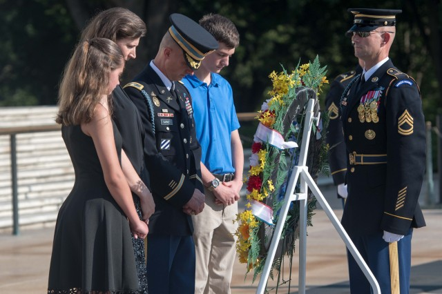 Col. Jason T. Garkey (center), outgoing commander, 3d U.S. Infantry Regiment, (The Old Guard), and his family participate in an Army Special Honor Wreath-laying Ceremony at the Tomb of the Unknown Soldier, Arlington National Cemetery, Arlington, Va., July 17, 2018. As Garkey departs The Old Guard, a wreath is laid to commemorate his more than two years of service as the regiment's commander. (U.S. Army photos by Spc. Gabriel Silva)