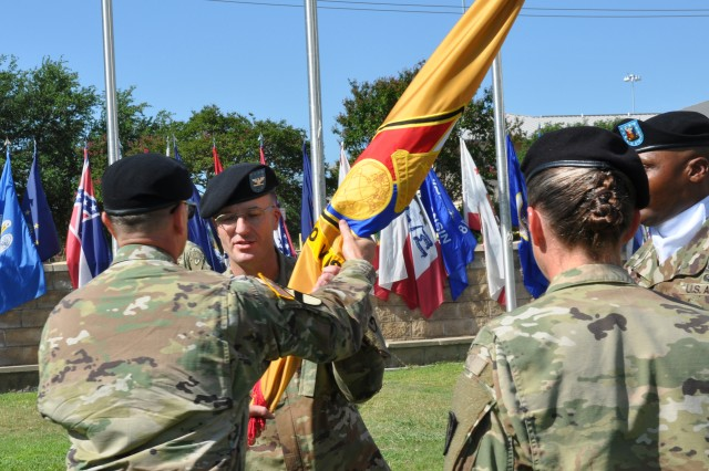 Col. Joel Greer accepts the 418th Contracting Support Brigade colors from Brig. Gen. Bill Boruff representing the passing of responsibility and authority of command during a ceremony July 12 at Fort Hood, Texas. Greer assumed command of the 418th CSB from Col. Lynda Armer in the ceremony officiated by Boruff, the commanding general of the Mission and Installation Contracting Command headquartered at Joint Base San Antonio-Fort Sam Houston, Texas.