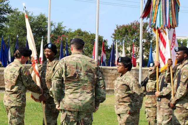 Lt. Col. Kizzy Danser accepts the 901st Contracting Battalion colors from Col. Lynda Armer representing the passing of responsibility and authority of command during a ceremony July 6 at Fort Hood, Texas. Danser assumed command of the 901st CBN from Lt. Col. Nate Bryant in the ceremony officiated by Armer, commander of the 418th Contracting Support Brigade at Fort Hood.