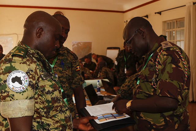 Justified Accord participants take part in a command post exercise during Justified Accord 2018 at the Ugandan Rapid Deployment Capability Center, Jinja, Uganda, June 27, 2018. JA18 promotes regional relationship, increases military and inter-governmental capacity as a collective unit, trains multinational forces and sector command staffs.