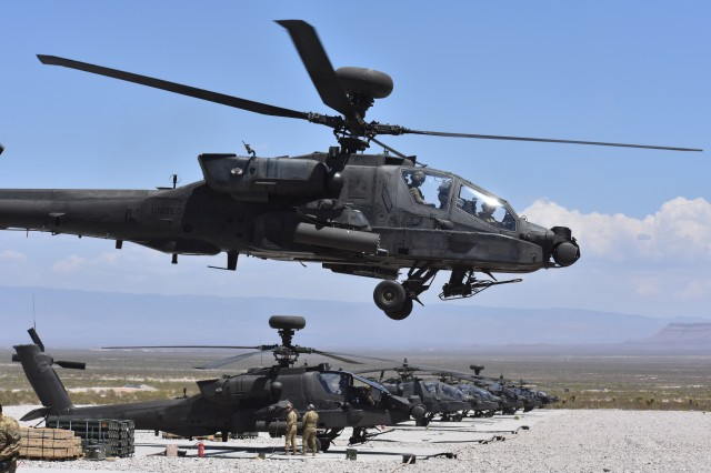 An AH-64 Apache helicopter takes off from a Forward Arming and Refueling Point during a 1st Battalion, 501st Aviation Regiment, Combat Aviation Brigade, 1st Armored Division, gunnery at Range 83 at Orogrande, N.M., April 23, 2018. Future Vertical Lift is one of the priorities of the new Army Futures Command.