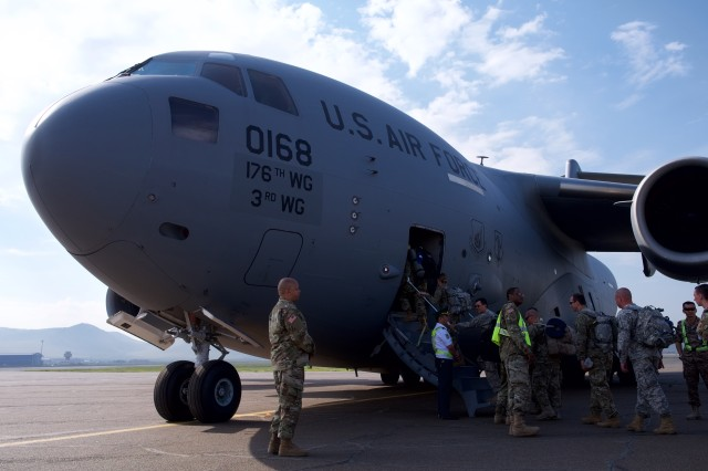 Soldiers of the 297th Regional Support Group board a 249th Airlift Squadron C-17 Globemaster III June 30, 2018, at Chinggis Khaan International Airport, Mongolia, after the Soldiers participated in Khaan Quest 2018. Khaan Quest is a combined (multinational) joint (multi-service) training exercise designed to strengthen the capabilities of U.S., Mongolian and other partner nations in international peace support operations.