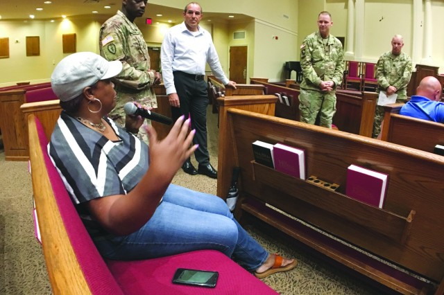 A Fort Stewart resident shares a concern with garrison commander Col. Jason Wolter and emergency services director Lt. Col. Martin Schmidt during Tuesday's safety and security town hall at the main post chapel. (Photo by Kevin Larson, Fort Stewart Public Affairs)