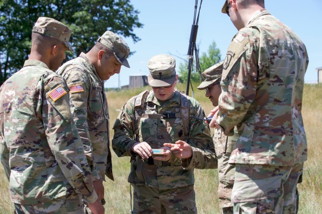 U.S. Army Spc. Matthew Campbell (center), 10th Brigade Support Battalion, 1st Brigade Combat Team, 10th Mountain Division (LI), uses the THOR III to detect and disrupt radio-controlled improvised explosive devices, or RC-IED's, during 1BCT's Company Crew Specialist Course, July 11, 2018.