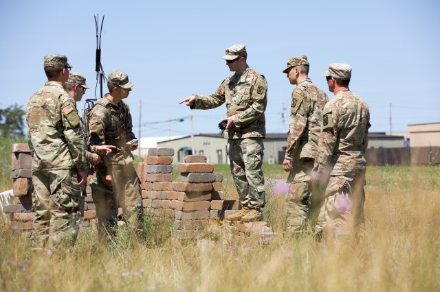 U.S. Army Sgt. 1st Class Jeremy Allen (center), an electronic warfare specialist, 1st Brigade Combat Team, 10th Mountain Division (LI), describes the functionality of the THOR III to 1BCT Soldiers during the Company Crew Specialist Course, July 11, 2018.