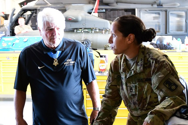 Sgt. 1st Class Elizabeth Chacon, a flight medic with Company C, 5th General Support Aviation Battalion, 159th Aviation Regiment, talks to Retired Spc. 5 Jim McCloughan about how much Army medicine has changed over the years. McCloughan was an Army medic when his actions in Vietnam earned him the Medal of Honor.