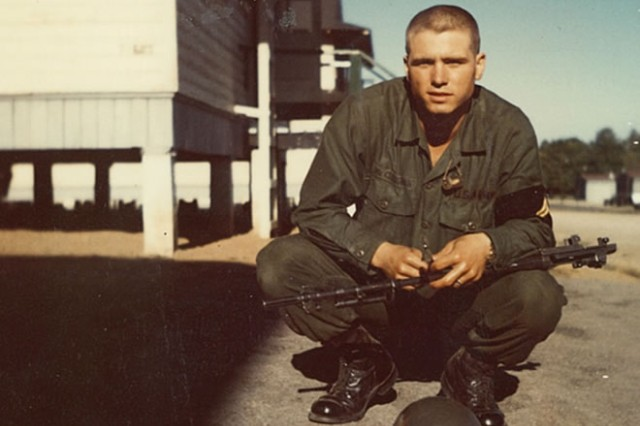 While cleaning his weapon, then-Pfc. James McCloughan poses for a photo in front of his barracks at Basic Combat Training in September 1968.
