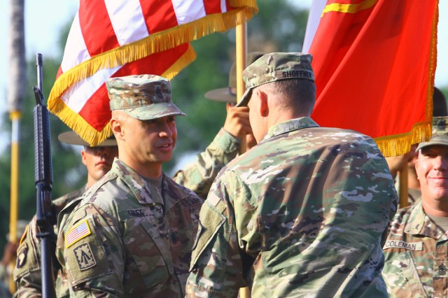 Command Sgt. Maj. John Foley receives the Fires Center of Excellence and Fort Sill colors from Maj. Gen. Wilson A. Shoffner, FCoE and Fort Sill commanding general, July 12, at the Old Post Quadrangle, during the assumption of responsibility ceremony.