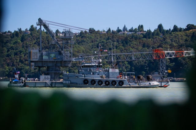 The large tug MG Henry Knox tows the barge derrick out to sea during Big Logistics-Over-the-Shore West, July 17, 2018. The large tug will tow the barge derrick to the coast of southern Oregon to simulate travel times between American military ports.