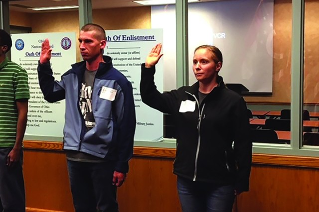 Nate and Irene Miller of Geauga County, Ohio, take the oath together May 25, 2018, at the Military Entrance Processing Station in Cleveland. The couple, married for four years, enlisted together into the Ohio Army National Guard and are scheduled to go to basic training in October, and will be assigned to the 1484th Transportation Company, based in North Canton, Ohio.