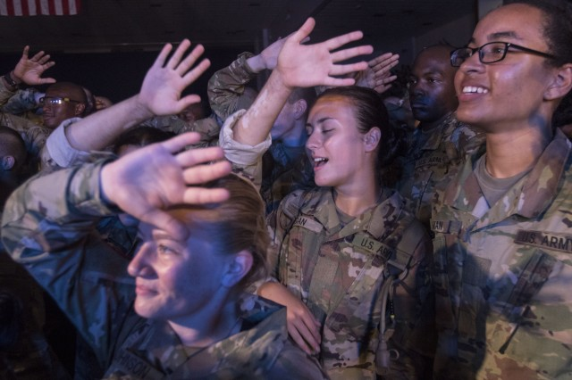 Fort Jackson trainees dance and worship during the 2018 Combined Protestant Worship Service July 14 at the Solomon Center. The yearly event sees the Billy Graham Ministries bring in top-tier Christian musicians to play a free concert to participating trainees.