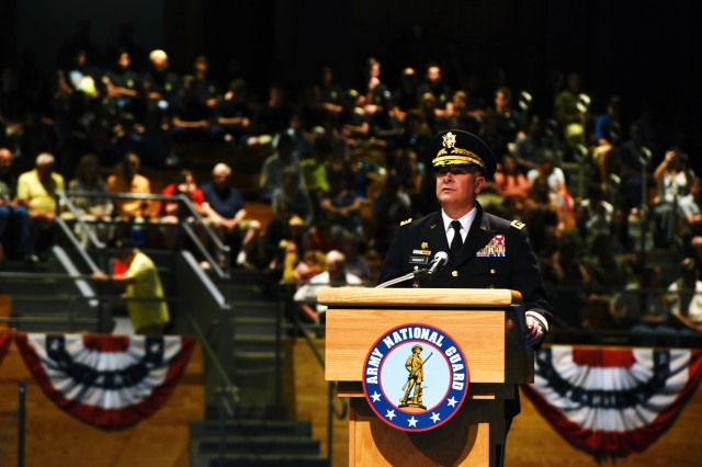 Army Lt. Gen. Timothy Kadavy, the director of the Army National Guard, speaks to more than 500 attendees during the Twilight Tattoo, July 18, 2018 at Joint Base Myer-Henderson Hall, Virginia. Kadavy served as host for the event, and recognized civilian employers of Guard members and administered the oath of enlistment to more than 50 future Soldiers.