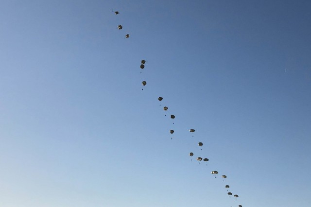 Paratroopers of the U.S. Army's 3rd Brigade Combat Team, 82nd Airborne Division jump from a C-17 Globemaster aircraft near Rukla, Lithuania June 9, 2018 as part of Swift Response 18, a multinational training exercise designed to maintain readiness and cohesiveness of participating units from several countries.  The 82nd Airborne Division began the mission at its home station of Fort Bragg, N.C., conducting a non-stop transcontinental flight that featured a mid-air refueling.  The exercise is scheduled for run June 7-15. (U.S. Army photo by 1st Sgt. Andrew Kosterman/22nd Mobile Public Affairs Detachment)