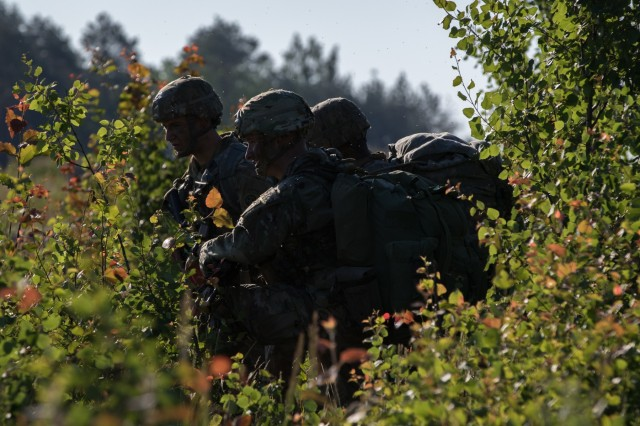 U.S. Army paratroopers assigned to 3rd Brigade Combat Team, 82nd Airborne Division, secure an airfield after jumping from an aircraft near Rukla, Lithuania, as part of Swift Response 18, June 9, 2018. Swift Response 18 is a multinational training exercise designed to maintain readiness and cohesiveness of participating units from several countries. The 82nd Airborne Division began the mission at its home station of Fort Bragg, N.C., conducting a non-stop transcontinental flight that featured a mid-air refueling. The exercise is scheduled to run June 7-15. (U.S. Army photo by Spc. Andrew McNeil / 22nd Mobile Public Affairs Detachment)