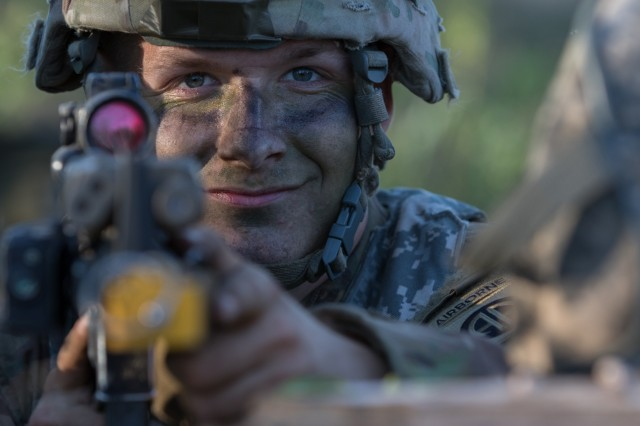 Spc. Lucas Underwood, a paratrooper assigned to the U.S. Army's 1st Battalion, 508th Infantry Regiment, 3rd Brigade Combat Team, 82nd Airborne Division, pulls security after jumping from an aircraft near Rukla, Lithuania, as part of Swift Response 18, June 9, 2018. Swift Response 18 is a multinational training exercise designed to maintain readiness and cohesiveness of participating units from several countries. The 82nd Airborne Division began the mission at its home station of Fort Bragg, N.C., conducting a non-stop transcontinental flight that featured a mid-air refueling. The exercise is scheduled to run June 7-15. (U.S. Army photo by Spc. Andrew McNeil / 22nd Mobile Public Affairs Detachment)