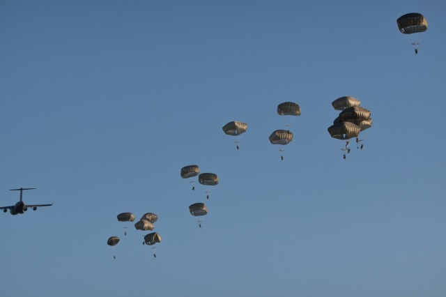 U.S. Army paratroopers assigned to the 3rd Brigade Combat Team, 82nd Airborne Division, jump from an aircraft near Rukla, Lithuania, as part of Swift Response 18 June 9, 2018. Swift Response 18 is a multinational training exercise designed to maintain readiness and cohesiveness of participating units from several countries. The 82nd Airborne Division began the mission at its home station of Fort Bragg, N.C., conducting a non-stop transcontinental flight that featured a mid-air refueling. The exercise is scheduled to run June 7-15. (U.S. Army photo by Spc. Andrew McNeil / 22nd Mobile Public Affairs Detachment)