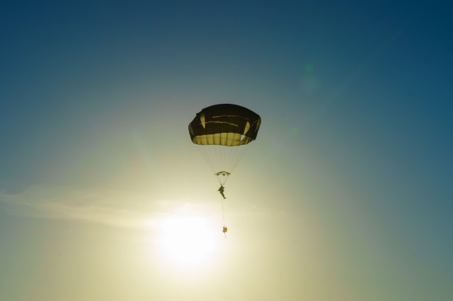 A U.S. Army paratrooper with the 3rd Brigade Combat Team, 82nd Airborne Division, descends to the ground after jumping out of an aircraft as part of Swift Response 18 at a training area near Rukla, Lithuania, June 9, 2018. Swift Response 18 is a multinational training exercise designed to maintain readiness and cohesiveness of participating units from several countries. Soldiers of the 3rd BCT started the training mission at their home station of Fort Bragg, N.C. and conducted a non-stop transcontinental flight that featured a mid-air refuel to conduct the jump into Lithuania. (U.S. Army photo by Sgt. Gregory T. Summers / 22nd Mobile Public Affairs Detachment)