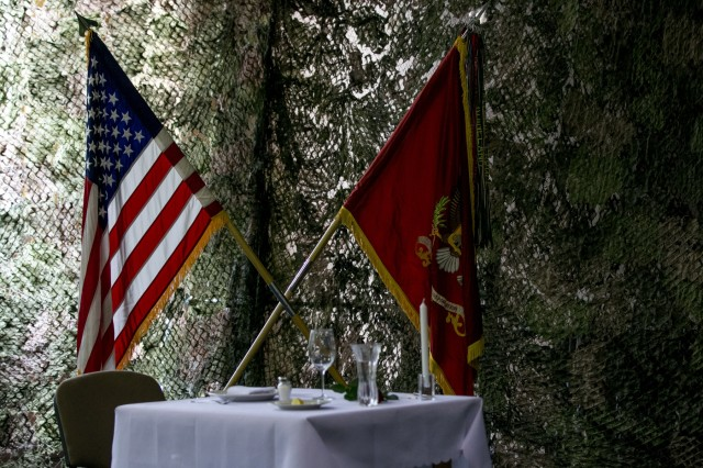 A table is set to honor past noncommissioned officers and their loved ones during an NCO induction ceremony held on May 11, 2018 in Poznan, Poland. The NCO induction ceremony is a celebration of the newly promoted joining the ranks of a professional noncommissioned officer corps and emphasizes and builds on the pride shared as members of such an elite corps. (U.S. Army photo by Spc. Dustin D. Biven / 22nd Mobile Public Affairs Detachment)