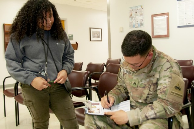 A Red Cross volunteer provides a patient experience survey to Sgt. Emmanuel Rivera, a culinary specialist with 1st Battalion, 36th Infantry Regiment, 1st Stryker Brigade Combat Team, 1st Armored Division, after Rivera's scheduled appointment as part of William Beaumont Army Medical Center Patient Assistance Office's mystery shopper program, which randomly allows patients to provide instant feedback regarding their experience during medical appointments or visits.