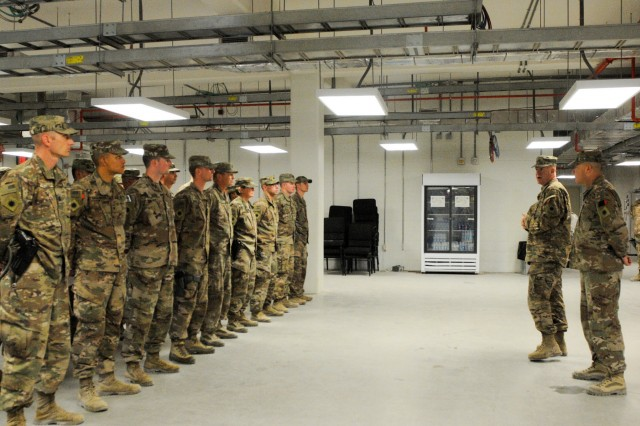 U.S Army Soldiers from the 40th Infantry Division, California National Guard, listen to the remarks from U.S. Army Brig. Gen. Jeffrey Smiley, commanding general for Train, Advise and Assist Command-South, July 15, 2018, during a patching ceremony in Kandahar Airfield, Afghanistan.