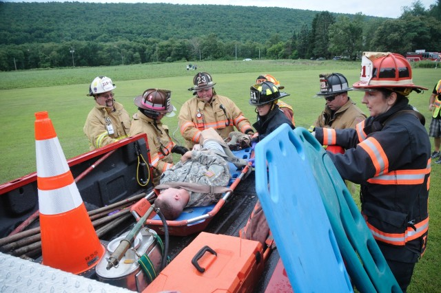 Civilian first responders from Dauphin and Schuylkill counties perform emergency care on a mock casualty of a simulated aviation disaster at Wiconisco, Pa., July 21, 2018.