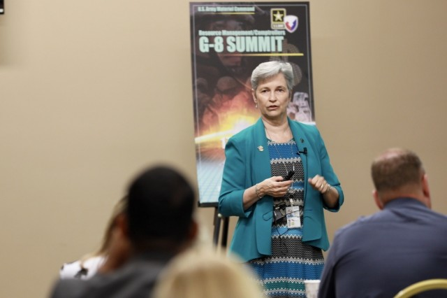 Sue Goodyear, Army Materiel Command's deputy chief of staff for resource management, speaks to enterprise personnel at the G-8 Summit.