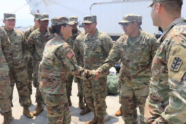 Lt. Col. Reyn Mann (center), 84th Engineer Battalion Commander and Cpt. Jeremy Reynolds (far right), 561st Engineer Construction Company Commander greets Soldiers returning from four-months aboard the USNS Mercy in support of Pacific Partnership 2018. Pacific Partnership is an annual multilateral mission featuring U.S. Service Members, partner nation military and government forces, humanitarian agencies, and non-governmental organizations. (Photo credit: 1st Lt. Eugene Molisso)