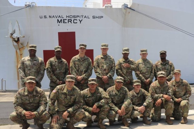 Soldiers from 561st Engineer Construction Company, 84th Engineer Battalion pose for a photo in front of USNS Mercy as part of their welcome home from Pacific Partnership 2018. Pacific Partnership is an annual multilateral mission featuring U.S. Service Members, partner nation military and government forces, humanitarian agencies, and non-governmental organizations.