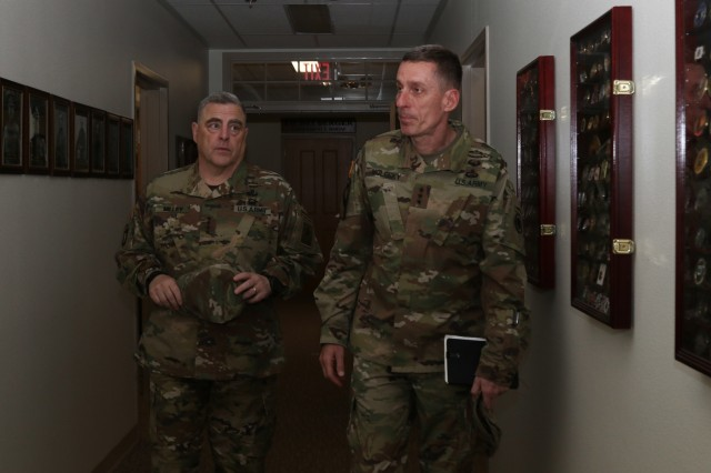 "Chief of Staff of the Army Gen. Mark A. Milley and America's First Corps Commanding General Lt. Gen. Gary Volesky talk about the photos of past Corps leaders lining the hallway at the I Corps headquarters on Joint Base Lewis-McChord, Washington, July 23, 2018. Milley visited JBLM to meet with Soldiers and leaders from I Corps, 7th Infantry Division, 1st Special Forces Group and 2nd Battalion, 75th Ranger Regiment. Milley discussed Soldier and Family readiness and the future of the force. Americas First Corps is celebrating its ""100 Years of Courage"" centennial throughout 2018. U.S. Army photo by Spc. Erica Earl"